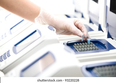 Scientist, DNA copying, Real-time PCR cycler, white gloves, distant