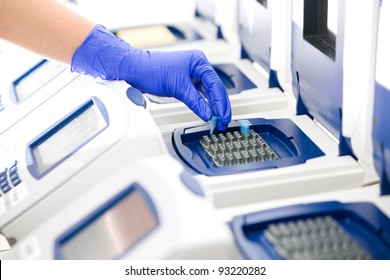 Scientist with DNA copying, Real-time PCR cycler, wide
