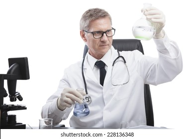 scientist or doctor is looking and analyze liquid test tube, in lab or hospital