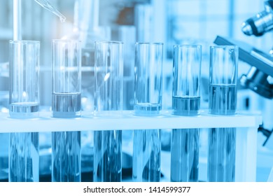 scientist with equipment and science experiments, laboratory glassware containing chemical liquid for research or analyzing a sample into test tube in laboratory.