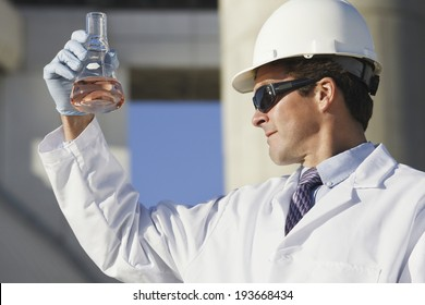Scientist experimenting with a water sample