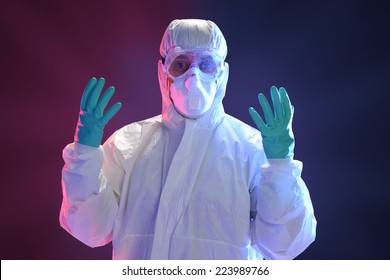 Scientist in full protective hazmat suit with dramatic lighting as background