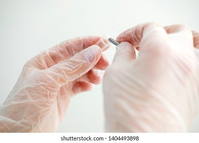 Scientist in gloves takes a sample for research in the laboratory. Hand of doctor putting biomaterial for analysis in test tube. Medical examination, microbiology.  Close up