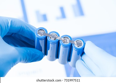 Scientist hold row of accumulators, research of new type of battery concept