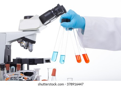 scientist is holding a bottle of substance in his hand
