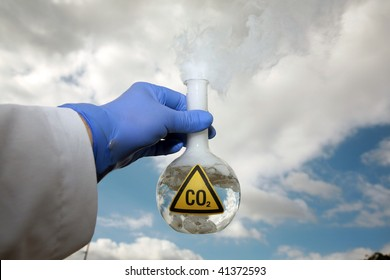 a Scientist holds a 500ml beaker filled with CO2 gainst the blue sky, representing  A Global Warming Time Bomb