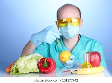 Scientist injecting GMO into the lemon