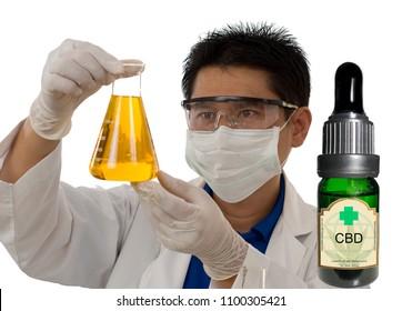 Scientist inspecting CBD oil in a laboratory