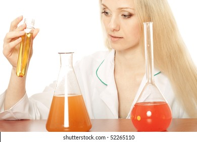 scientist in lab with flasks