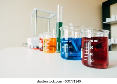 scientist in the laboratory working at lab with test tubes