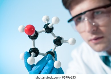 scientist looking at a molecular structure in the lab