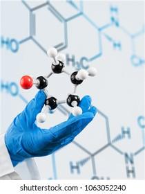 Scientist man holding molecule