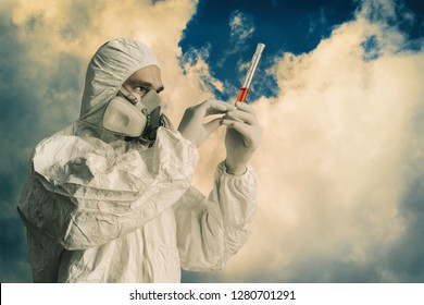 Scientist in a protective suit takes samples. Сure for the virus.