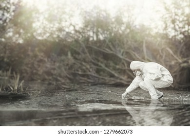 Scientist in a protective suit takes water samples. Сure for the virus.