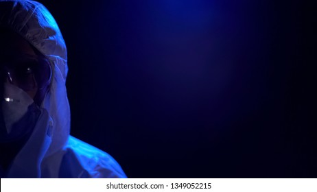 Scientist protective uniform on dark background, chemical experiment, epidemic