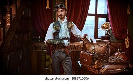 Scientist steampunk man inventor works in his laboratory with Victorian interior. Adventure world of steampunk.