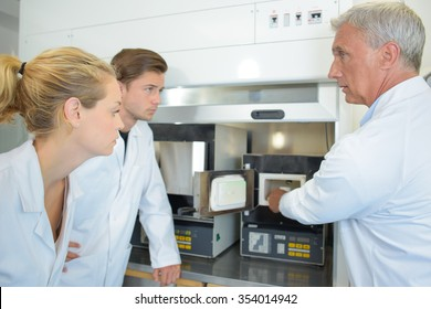 Scientist taking product from cabinet