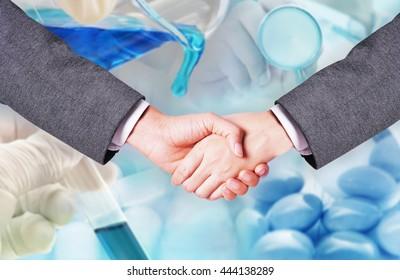 scientist team hand shake , medicine research at science lab