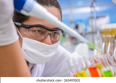 Scientist test dosage drop tube in the laboratory