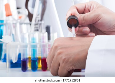 The scientist testing skincare products (serum, essential oil, cream, lotion) for safety and efficacy and harmless, Cosmetic beauty product laboratory testing concept.