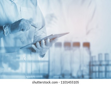 scientist using tablet in the laboratory,Laboratory research concept,science background