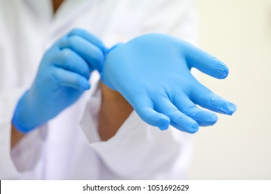 scientist wearing glove.