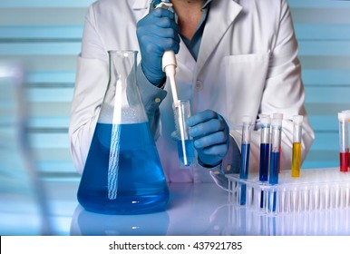 scientist working in chemical lab / chemist engineer working with fluids in laboratory