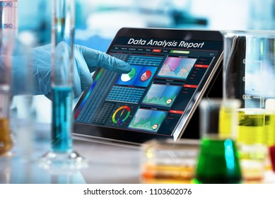 scientist working experiment with a computer in the laboratory / researcher working with data analysis report in digital tablet of the lab