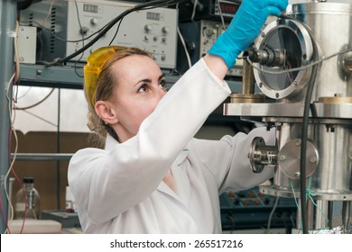 Scientist working in a liquid nitrogen bank. Cryopreservation of reproductive cells in programm mode.