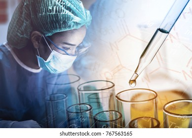 Scientist working in the operating room with dropping chemical liquid to test tube, medical research and development concept