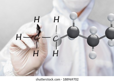 scientist in working suit drawing chemical structure