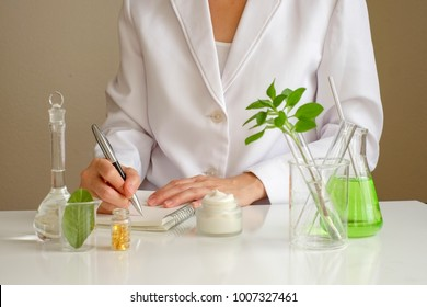 the scientist,dermatologist formulate organic natural cosmetic product in the laboratory.research and development beauty skincare .cream,serum.hand