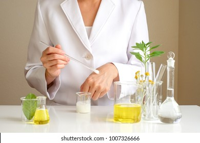 the scientist,dermatologist testing the organic natural cosmetic product in the laboratory.research and development beauty skincare .cream,serum.hand