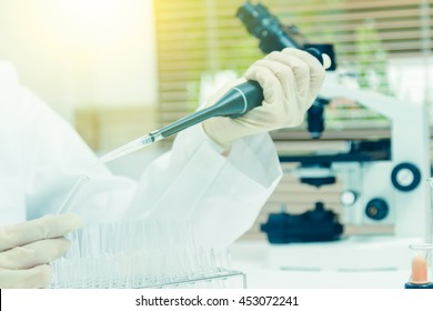Scientists are certain activities on experimental science like mixing chemicals, use microscope, entry data to develop science medicines, foods for everyone on the world, copy space, film effect.