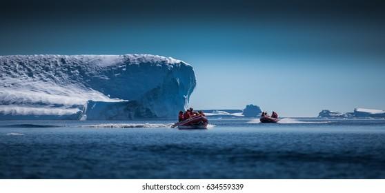 Scientists explore Antarctic Icebergs by boat
