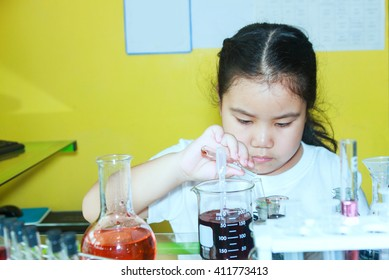 Scientists junior is a very happy or fun to make and play chemical science experiment in science class, copy space, mock-up, web template for design or decorate your content, Asia girl 8 year.