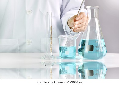 Scientists researching in laboratory, Chemist holding scientific glassware equipment, Healthcare and research concept.