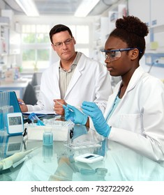 Scientists, senior Caucasian male and young African female, work in the lab. Shallow DOF, focus on the girl.