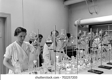 Scientists testing fatty acids in laboratory