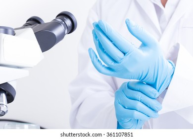 Scientists wear gloves.
