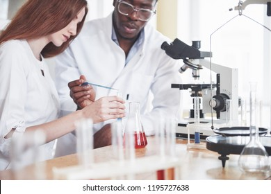 Scientists work closely with the microscope in the laboratory by conducting experiments and analyzes