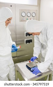 Scientists working with hazardous material in the lab