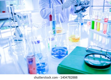 A Scientists are working in the laboratory.,A 18s students are testing in the classroom.