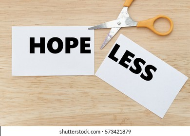 Scissor cut the paper to change from HOPELESS to HOPE. Concept of change, positivity,hope,motivation
