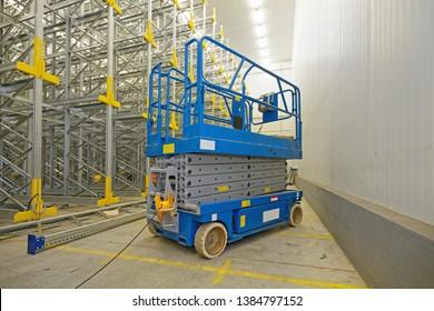 Scissor Lift Aerial Work Platform in Distribution Warehouse
