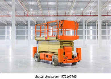 Scissor Lift Aerial Work Platform at a construction site.