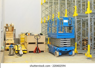 Scissor lift at construction site in distribution warehouse