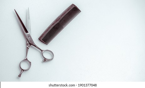 scissors and comb. Professional hairdresser tools, isolated on white