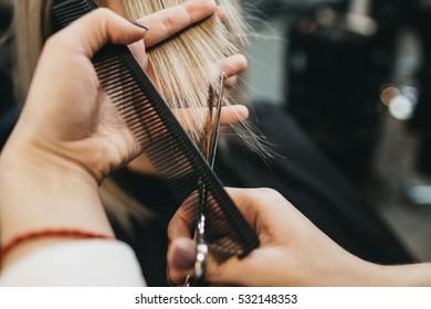Scissors cut the girls hair