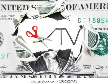 Scissors cutting a cable TV cord over money